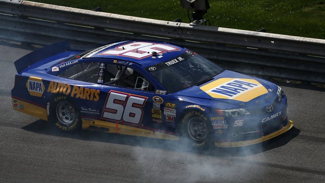 Smoke pours from the Toyota of Martin Truex Jr. during the FedEx 400 benefiting Autism Speaks at Dover International Speedway. Truex did not finish the race.