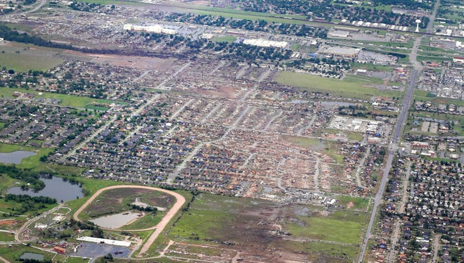 This aerial photo shows the remains of houses in Moore, Okla., following a tornado on May 20. The Oklahoma City area has seen two of the extremely rare EF5 tornadoes in 11 days.