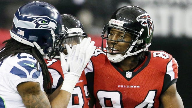 Seahawks CB Richard Sherman, left, and Falcons WR Roddy White (84) are sure to be yapping Nov. 10 when they meet again.