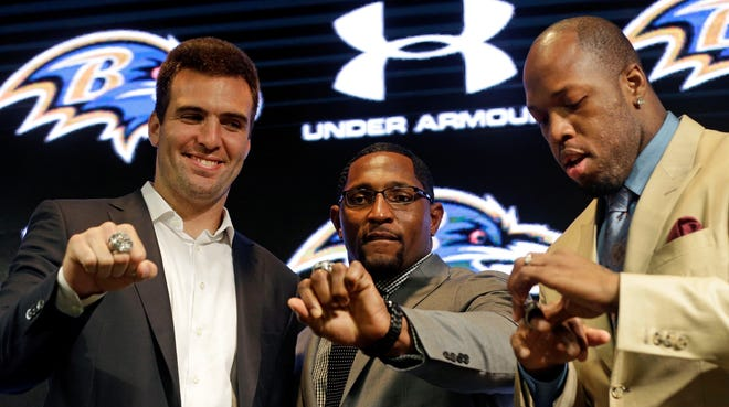 From left to right, Baltimore Ravens quarterback Joe Flacco, former linebacker Ray Lewis and linebacker Terrell Suggs check out their Super Bowl XLVII championship rings after receiving them at a ceremony at the team's NFL football practice facility in Owings Mills, Md., Friday, June 7, 2013. The Ravens defeated the San Francisco 49ers 34-31 to win their second franchise Super Bowl. (AP Photo/Patrick Semansky) ORG XMIT: MDPS104