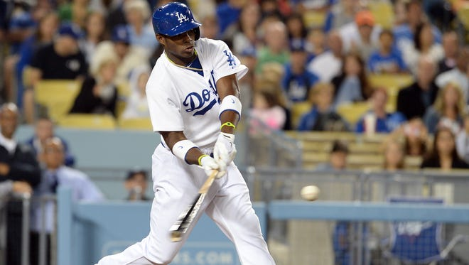 Los Angeles Dodgers right fielder Yasiel Puig connects on a home run in the sixth inning of the game against the Atlanta Braves at Dodger Stadium.