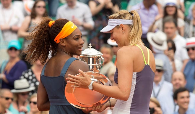 The trophies in hand for Serena Williams and Maria Sharapova.