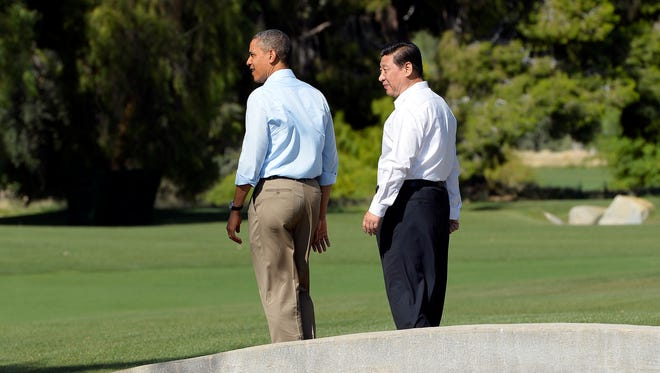 President Obama and Chinese President Xi Jinping take a walk at the Annenberg Retreat at Sunnylands in Rancho Mirage, Calif., on Saturday.
