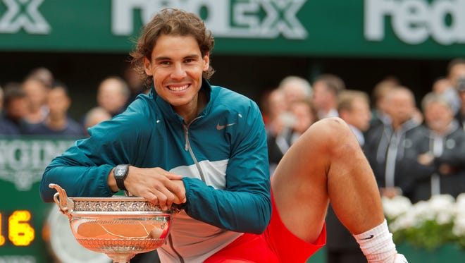 Rafael Nadal poses with his trophy.