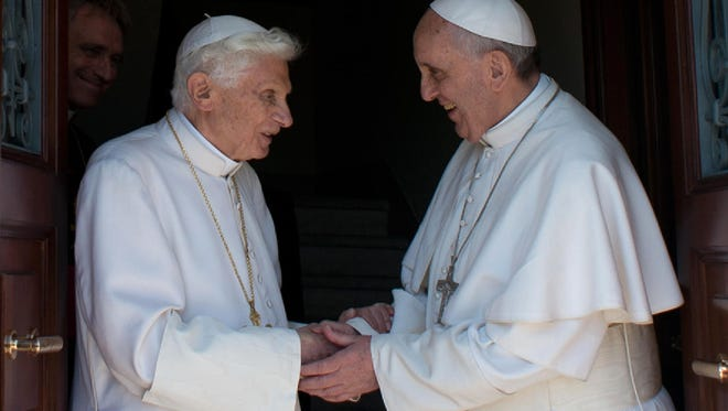 Pope Francis, right, greets Pope Emeritus Benedict XVI at the Mater Ecclesiae monastery, Benedict's new residence, upon his arrival at the Vatican from Castel Gandolfo on May 2.