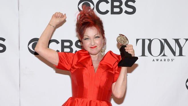 Cyndi Lauper poses with her Tony award.