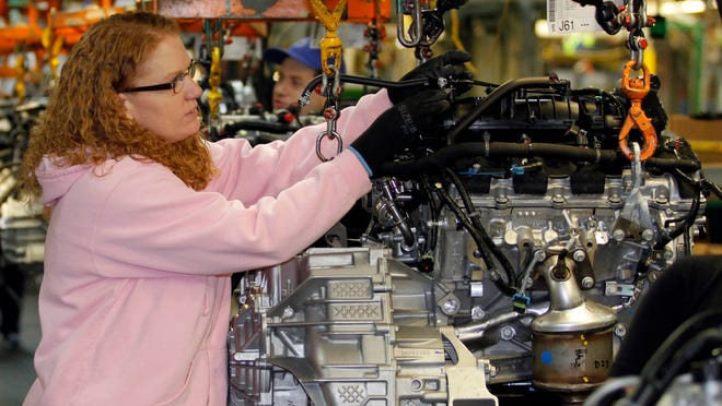 Tina Knudson works in engine assembly at the General Motors Fairfax Assembly and Stamping Plant in Kansas City, Kans. GM is investing millions there and adding new workers