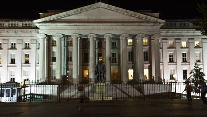 """Standard , Poor's Ratings Services upgraded the U.S. government's debt outlook from """"Negative"""" to """"Stable."""" The U.S. Treasury Department is pictured in 2011 after S,P cut the U.S. credit rating for the first time in history."""
