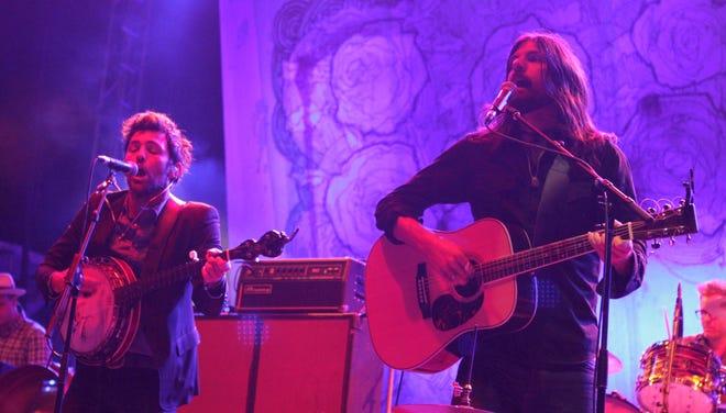 Scott Avett, left, and Seth Avett of the band the Avett Brothers performs at the Governors Ball Music Festival on Sunday, June 9, 2013, in New York.