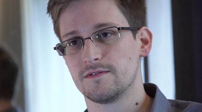 """In this handout photo provided by """"The Guardian"""" newspaper, Edward Snowden speaks during an interview in Hong Kong."""