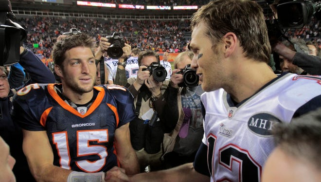 Tim Tebow and Tom Brady (12) may now be teammates, but there's no question who's on top of the depth chart.