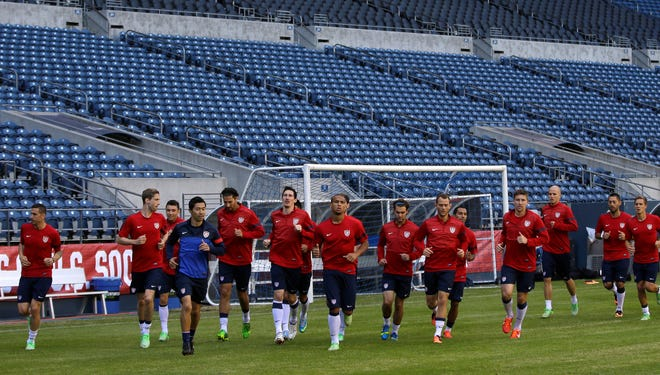 U.S. national team soccer players warm up June 10, 2013 as they prepare for their World Cup qualifying match against Panama.