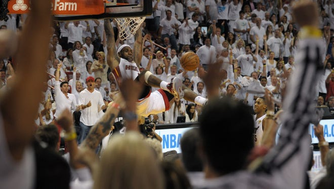 Heat forward LeBron James delights the Miami crowd with a dunk in Game 2 of the NBA Finals.