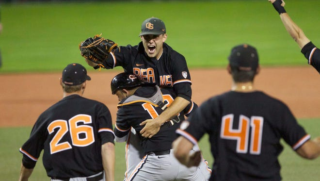 Oregon State Beavers pitcher Matt Boyd (31) is hugged by catcher Jake Rodriguez after defeating the Kansas State Wildcats 4-3 in the Corvallis Super Regional at Goss Stadium.