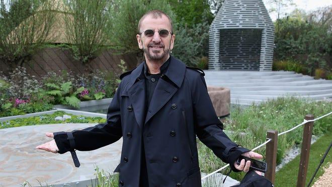 Ringo Starr poses  in a garden in London.