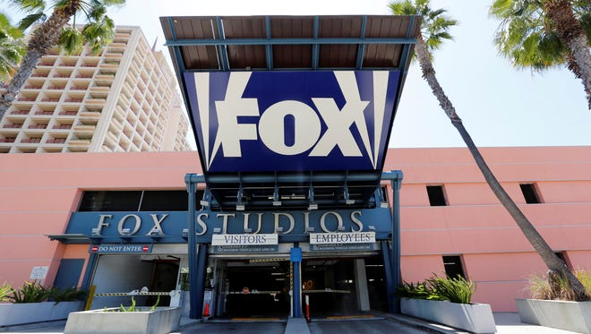 An entrance to a parking garage at 20th Century-Fox studios, an entity currently owned by News Corporation. 20th Century-Fox studios will become a holding of the new 21st Century Fox company after Newscorp splits. (AP Photo/Reed Saxon)