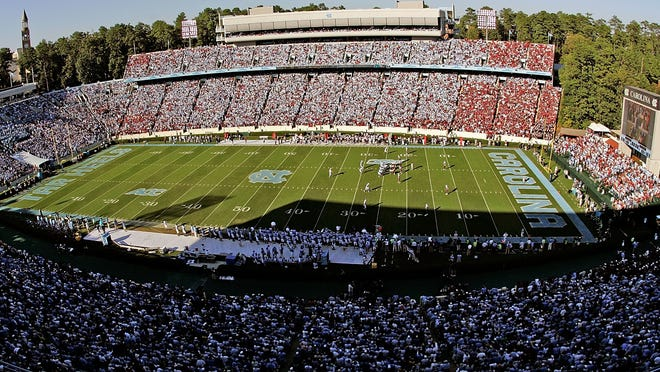 """Emails obtained by a Raleigh, N.C., newspaper show former North Carolina academic department head Julius Nyong'oro was offered football tickets and a chance to be a """"guest coach"""" on the sideline at Kenan Stadium by academic advisers working in the UNC athletics department."""