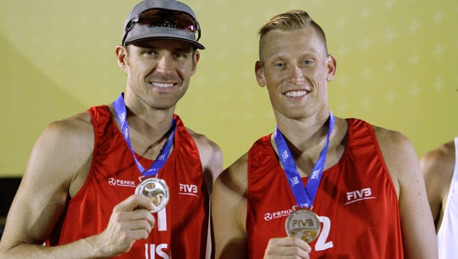 Jake Gibb (left) and Casey Patterson  display their silver medal after the final match between USA and Latvia as part of the Corrientes Grand Slam on May 26, 2013 in Corrientes, Argentina.