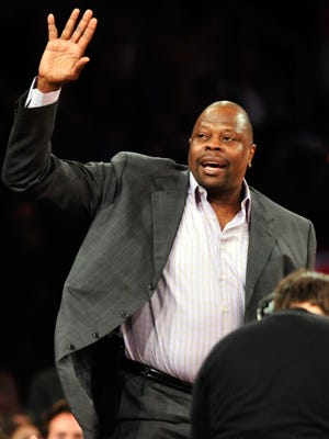 Patrick Ewing waves to the Madison Square Garden crowd while watching a Knicks game March 31 vs. the Celtics.