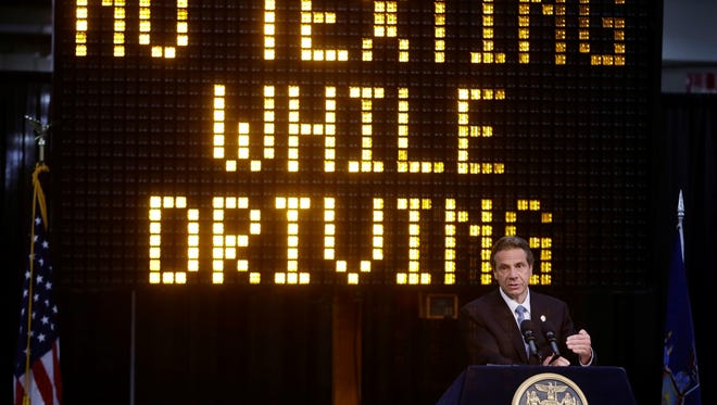 New York Gov. Andrew Cuomo speaks during a news conference to announce the increase in penalties for texting while driving on May 31, 2013, in New York.