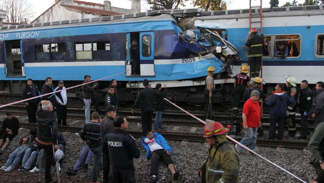 Firefighters and rescue workers respond to a fatal commuter train wreck on the outskirts of Buenos Aires, Argentina, on Thursday.