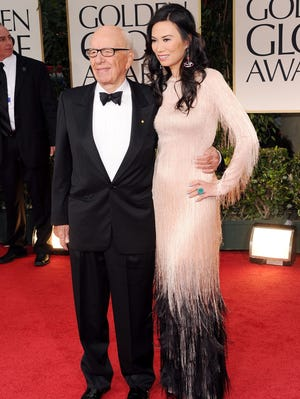 Rupert Murdoch has filed for divorce from third wife Wendi Deng, pictured here in happier times at Golden Globes in January 2012.
