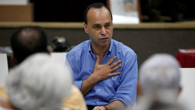 Rep. Luis Gutierrez, D-Ill., talks during a reunion with residents in Vieques, Puerto Rico, Thursday, May 2, 2013.
