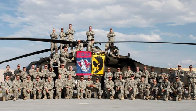 Soldiers of Company C, 2nd Battalion, 147th Aviation Unit based in Boone, Iowa, pose for a unit photo in November 2010 while deployed to Camp Bondsteel, Kosovo.