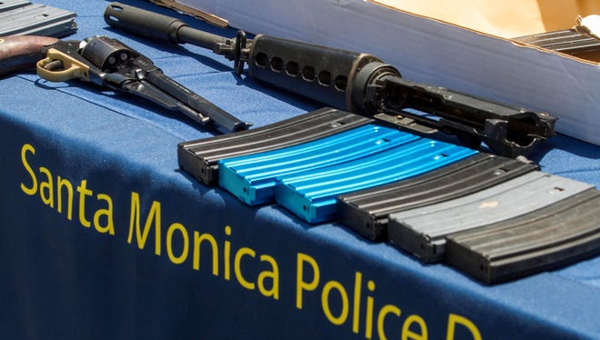 Weapons recovered from Santa Monica College are displayed during a news conference, June 8, 2013, held by Santa Monica Police in Santa Monica, Calif.