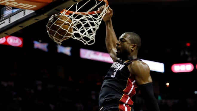Game 4 in San Antonio: Heat 109, Spurs 93 --  Miami Heat shooting guard Dwyane Wade dunks against the San Antonio Spurs during the fourth quarter.