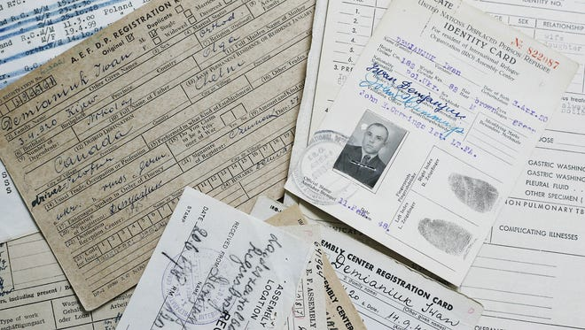 The reproduction of documents, including an identity card for former Sobibor death camp guard John Demjanjuk, then known as Ivan, from the year 1948.