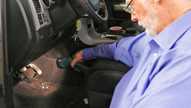 Earl Stewart, owner of Earl Stewart Toyota, shows the faulty accelerator pedal  on one of the recalled vehicles in North Palm Beach, Fla., in 2010