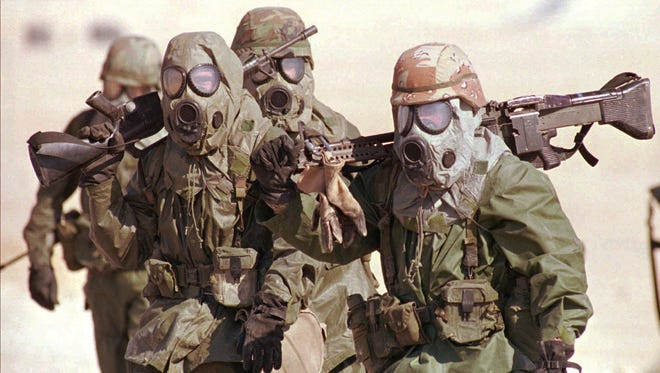 Soldiers from the 24th Mechanized Infantry Brigade from Fort Stewart, Ga., carry their weapons as they undergo chemical training in eastern Saudi Arabia during Operation Desert Shield in this November 1990 photo. About 30% of the 700,000 veterans of the war cite some kind of symptoms linked to Gulf War Illness.