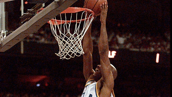 The lawsuit is on behalf of roughly a dozen former athletes, including former UCLA basketball star Ed O'Bannon.