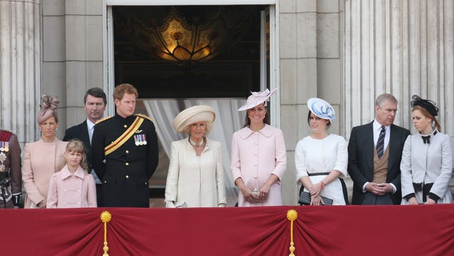 Duchess Kate joins royal family, including Prince Harry and Camilla Duchess of Cornwall in center, on Buckingham Palace balcony during Trooping the Color ceremony.