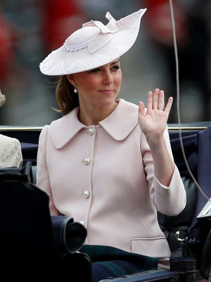 Kate arrives back at Buckingham Palace in her horse-drawn carriage after the Trooping the Color parade on June 15. It may be her last appearance in public before giving birth next month.