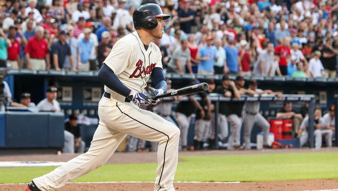 Atlanta Braves first baseman Freddie Freeman hits a walk-off single in the ninth inning against the San Francisco Giants at Turner Field.