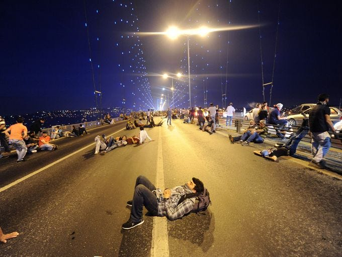 People rest on Bosphorus bridge as they march from Anatolian side to European side to Taksim Square in Istanbul.