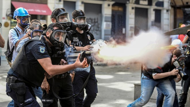 Police fire tear gas as riot police spray water cannon at demonstrators who remained defiant in Istanbul, Turkey, on Sunday.
