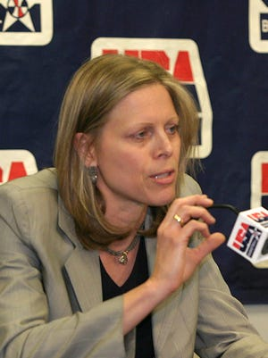 Former USA Basketball President Val Ackerman, left, speaks during a news conference in 2005.