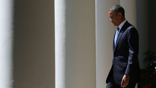 President Obama walks to the Rose Garden from the White House on June 4.