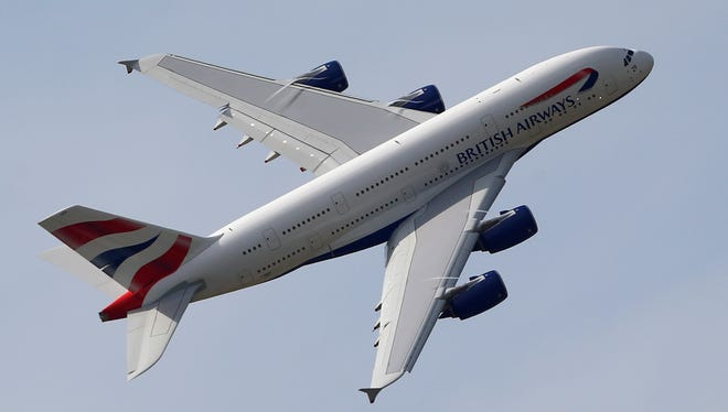 A British Airways Airbus A380 aircraft performs its demonstration flight during the first day of the 50th Paris Air Show at Le Bourget airport, north of Paris, Monday, June 17, 2013.