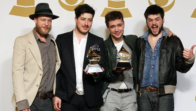 Ted Dwane, left, posed with Marcus Mumford, Ben Lovett and Winston Marshall  backstage at the Grammys in February.