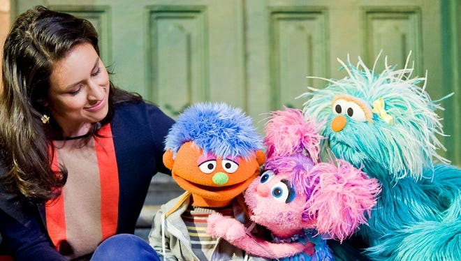 Characters Sofia, Abby and Rosita comfort Alex as part of the Little Children, Big Challenges incarceration initiative from 'Sesame Street.'
