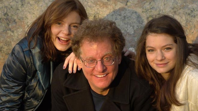 Bruce Kluger and his daughters, Bridgette, left, and Audrey.