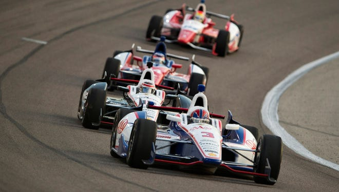 Helio Castroneves (3) drives through turn two during the Firestone 550 at Texas Motor Speedway.