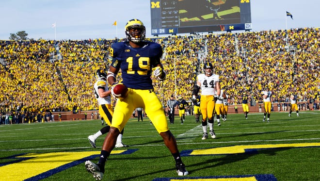 Michigan tight end Devin Funchess (19) scores a touchdown against Iowa in the third quarter of a 25-point Wolverines win at Michigan Stadium on Nov 17, 2012. The Wolverines' athletic department, helped by a large fan base that fills the stadium for every home, is one of 23 a NCAA members schools that operated in the black in the most recent year reported.