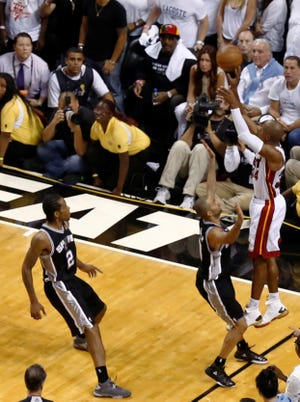 Heat guard Ray Allen makes the three-pointer to send Game 6 of the NBA Finals to overtime. Miami won 103-100.