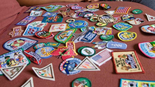 A photo of U.S. Girl Scout merit and activity badges.