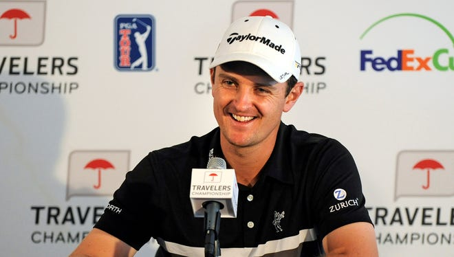 Justin Rose flashes a smile Wednesday during a news conference for the Travelers Championship.